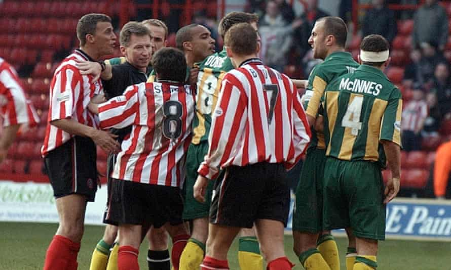 Sheffield United and West Bromwich Albion players square up at Bramall Lane in March 2002. Referee Eddie Wolstenholme attempts in vain to keep the peace