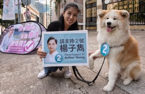 Dawn with her dog Chicco who is in favour of a proposed dog park supports candidate Arthur Yeung.