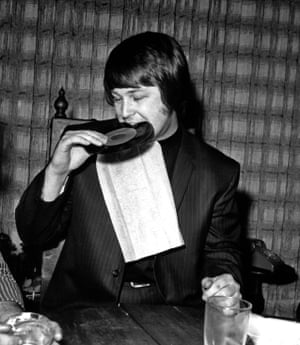 Brian Wilson of the Beach Boys in Los Angeles, in 1968, biting on a record