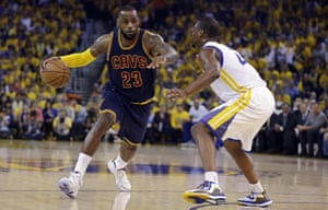 Cleveland Cavaliers forward LeBron James drives against Golden State Warriors forward Harrison Barnes during game 1 of basketball's NBA finals.