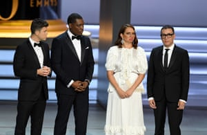 (L-R) Colin Jost, Michael Che, Maya Rudolph, and Fred Armisen speak onstage.