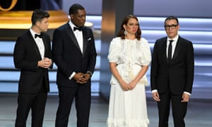 Colin Jost, Michael Che, Maya Rudolph, and Fred Armisen speak onstage during the 70th Emmy Awards.