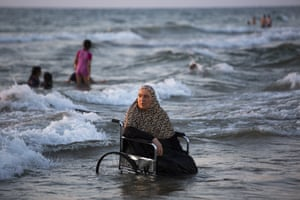 Tel Aviv, IsraelA woman from the West Bank town of Qalqilya sits in wheelchair in the mediterranean sea during the Eid Al Adha festival. Palestinians visited Tel Aviv and other parts of Israel after they were granted travel permits.