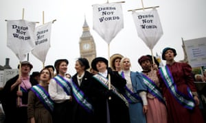 Feminist activists dressed as The Suffragettes, women who historically demanded the right to vote, protest at Parliament Square for women's rights and equality in London.
