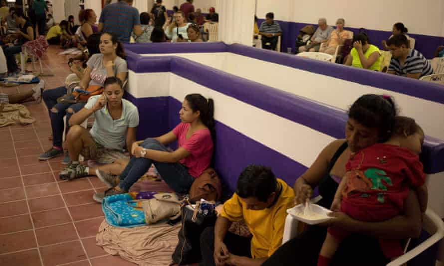 People wait for the arrival of hurricane Patricia at a shelter in the Pacific resort city of Puerto Vallarta, Mexico, on Friday.