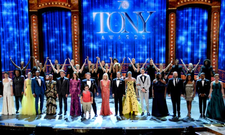 Host James Corden, centre left, and nominees perform at the Tony awards.