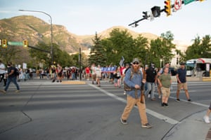 Opposing protest groups march on opposite sides of the street in Provo.