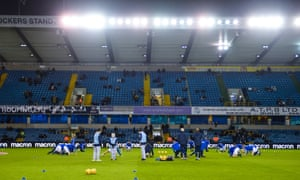Millwall players warm up at The Den, which the club now hope to redevelop