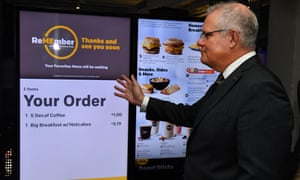 Scott Morrison inspects an interactive menu in Chicago while other leaders attend the climate summit