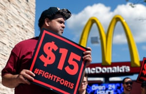 Supporters of a $15 minimum wage for fast food workers rally in front of a McDonald's in Albany, New York State.