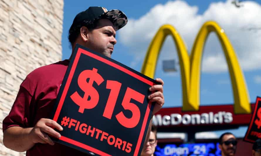 Supporters of a $15 minimum wage for fast food workers rally in front of a McDonald's last year.