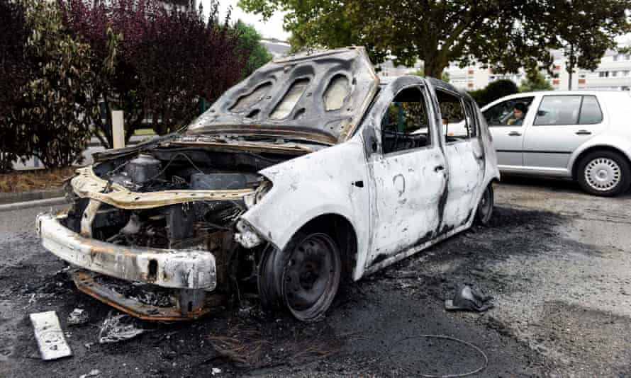 The wreckage of a burnt-out car in Nantes.