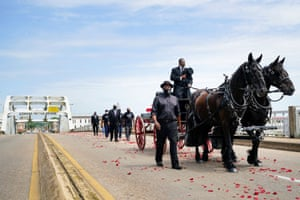 The casket of late US Congressman John Lewis, a pioneer of the civil rights movement and long-time member of the US House of Representatives, is carried via horse-drawn carriage across the Edmund Pettus Bridge in Selma.