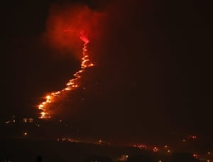 A wall of flame approaches homes in Herriman, Utah, where more than 1,200 homes have been evacuated.