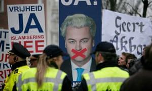 Geert Wilders supporters holding posters.