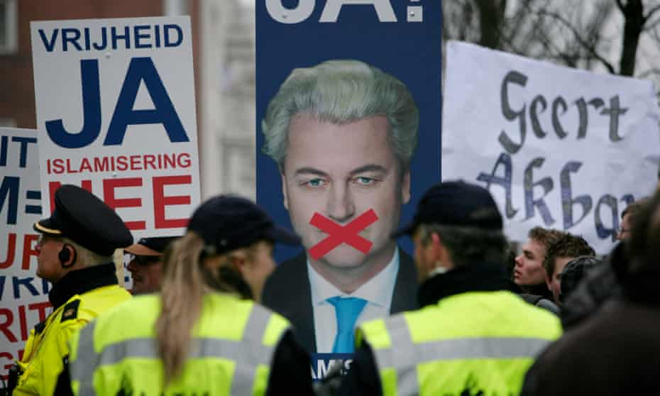 A 2010 rally in support of Geert Wilders during his trial for inciting racial hatred, with posters reading 'Freedom Yes, Islamisation No' and 'Geert is Great'