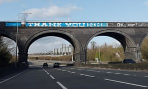 "A ""Thank You NHS"" message has been daubed over the ""Give peas a chance"" graffiti on the side of a railway bridge on the M25."