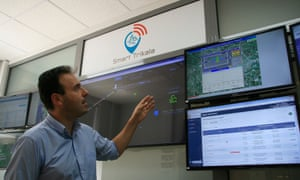 The city's mayor, Dimitris Papastergiou, inside the control room which monitors everything from parking spaces to the town hall's monthly budget.