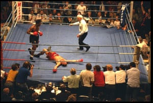 Nigel Benn looks down at Louis Gent sprawled on the canvas after knocking him down during their WBC Super Middleweight World Title fight in June 1993. Benn won the fight in the fourth round.