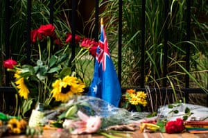An Australian flag at a memorial for Justine Damond serves as a reminder of how this US police shooting has differed from others.