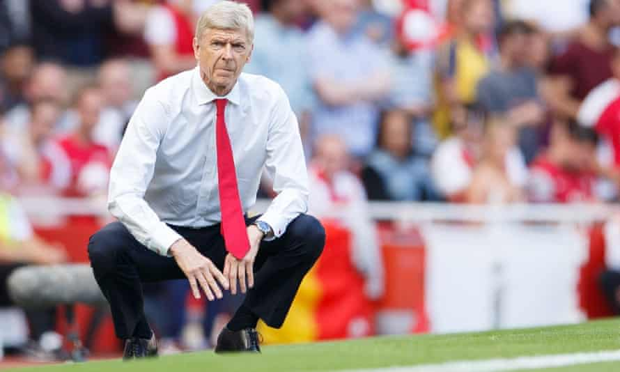 Arsène Wenger watches on during the defeat to Liverpool.
