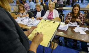 Staff count ballot papers at the Emirates Arena in Glasgow, Scotland, after polls closed in the EU referendum.