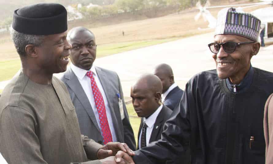 Osinbajo, left, greets Buhari as he returns to Abuja.