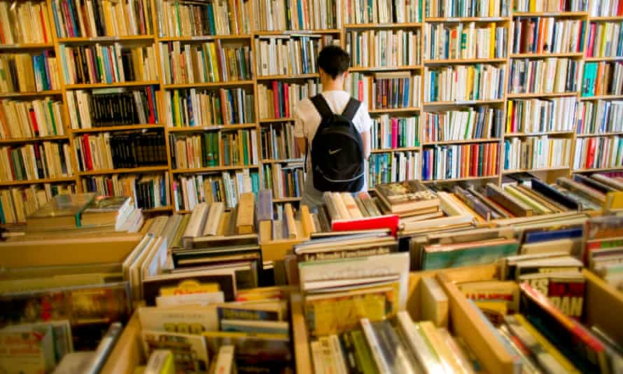 Browsing in one of the town's secondhand bookshops. Fontenoy-la-Joûte, France.