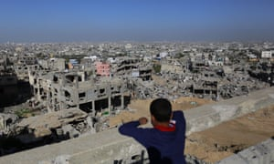 A Palestinian youth looks at rubble of houses which were damaged during the 50-day Gaza war between Israel and Hamas-led militants
