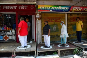 Social distancing whilst queueing outside a medical store in Allahabad