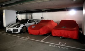 A collection of sports cars in the parking garage at the Vista development, to which the Payments have no access.