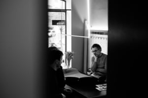 Picture of a man thinking, through a partially open doorway