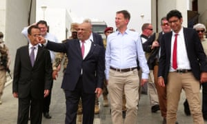 Yemen's foreign minister, Khaled al-Yamani gestures as he walks with Jeremy Hunt in Aden, Yemen.