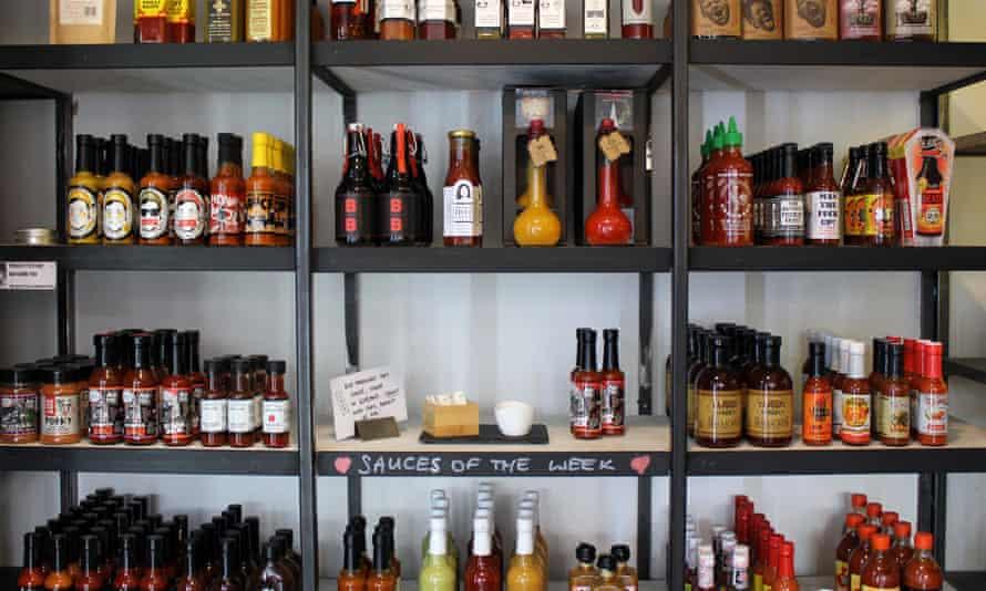 The shelves at beer, hot sauce and vinyl emporium Hop Burns & Black.