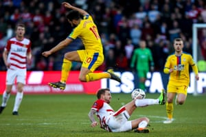 The Doncaster Rovers midfielder James Coppinger tackles Andros Townsend of Crystal Palace