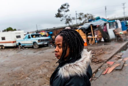 Fife stands outside a homeless encampment in Oakland in January.
