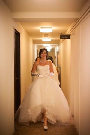 Naomi Harris leaving a hotel room in a wedding dress