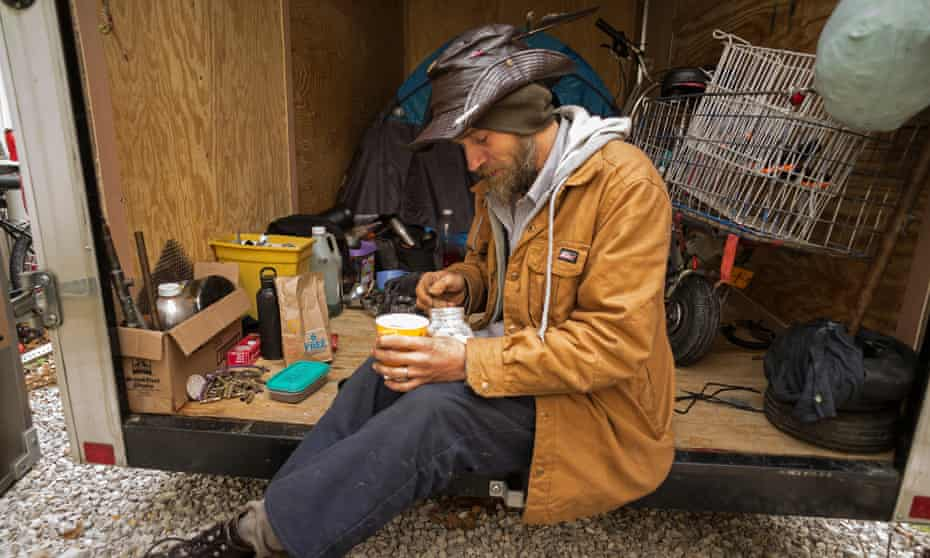 Alex Dezanett lives in a tent pitched in a horse trailer in Beattyville.
