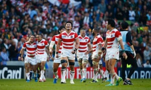 Japan players celebrate their surprise victory.