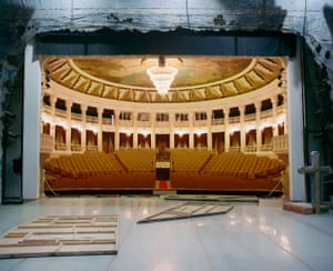 This image depicts the interior of the Buryat State Academic Opera and Ballet theatre. Construction began before the second world war, but it wasn't until 1952 that it was officially opened with a striking plaster mural, the 'Friendship of People', consisting of 15 full-size human figures in grandiose Soviet poses of strength and solidarity