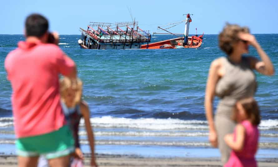 The sunken fishing vessel, believed to be carrying Vietnamese asylum seekers, off the beach at Cape Kimberley at the mouth of the Daintree River in Queensland.