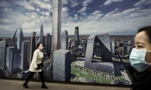 A Chinese woman wears a mask while passing a billboard showing the city on a clear day A Chinese woman wears a mask while passing a billboard showing the city on a clear day