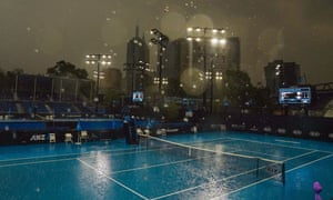 Heavy, and much welcome, rain falls at Melbourne Park ahead of the Australian Open.