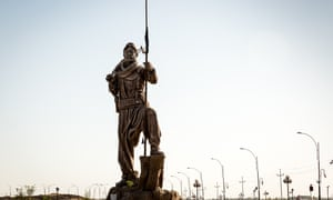 A Peshmerga statue outside Kirkuk pays tribute to Kurds who fought against Isis.