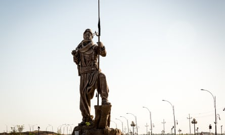 A Peshmerga statue outside Kirkuk pays tribute to Kurds who fought against Isis.