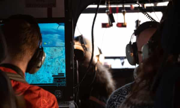 Researchers in a specially adapted plane search for simulated bear dens in a study in Utah.