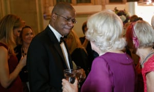 Paul Beatty meets Camilla, Duchess of Cornwall as he wins the Man Booker prize in London.