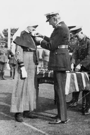 Lord Forster, governor general of Australia, presents the military medal to staff nurse Pearl Corkhill in August 1918 at Victoria Barracks, Sydney. She was honoured for her courage and presence of mind when the British army's No 38 casualty clearing station, to which she was temporarily attached, was bombed by enemy aircraft. She was one of the few nursing sisters to receive the medal.