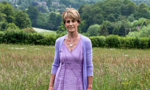 Dr Amanda Brown in a lilac dress in the countryside