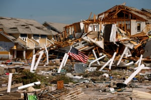 An American flag flies amongst rubble in Mexico Beach. At least 280 people stayed in town for the storm, and many were unaccounted for